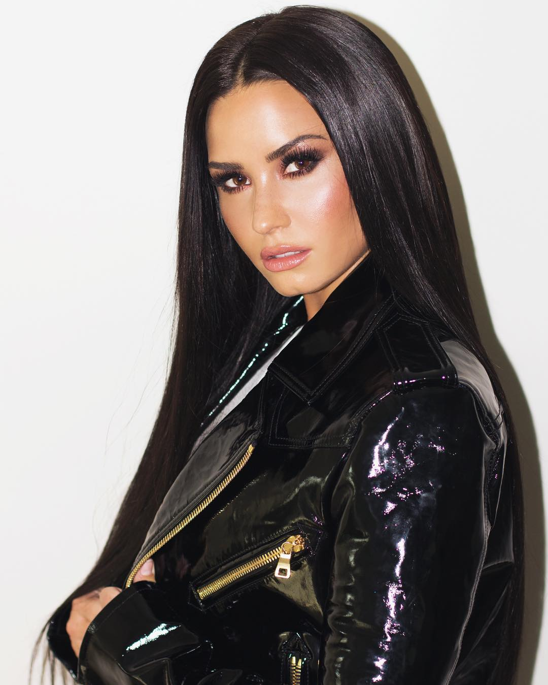 Demi Lovato With Mid Part Sleek Long Hair Wearing Black