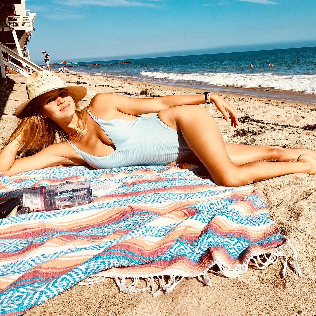 Kelly Rohrbach Wearing Pastel Blue Swimsuit With A Straw Sunhat 2021