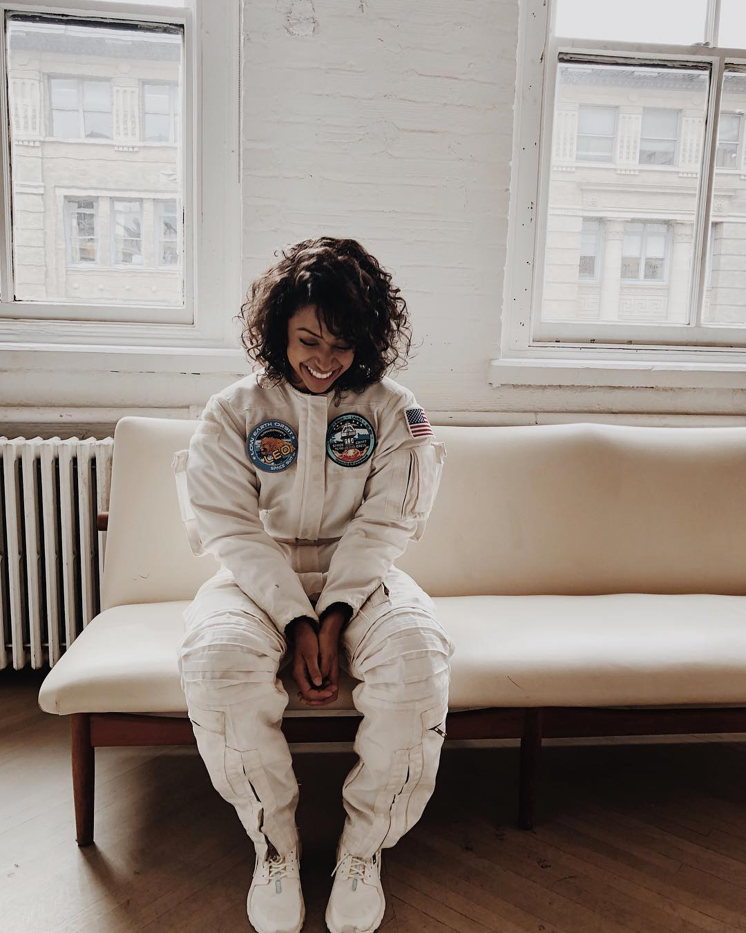 Liza Koshy With Curly Bob Hairstyle In Astronaut Suit Promoting Her Apparel 2020