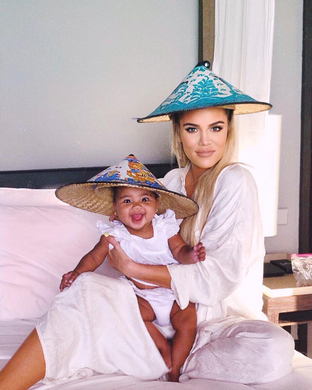 Khloé Kardashian With Her Daughter In Asian Conical Hats 2020