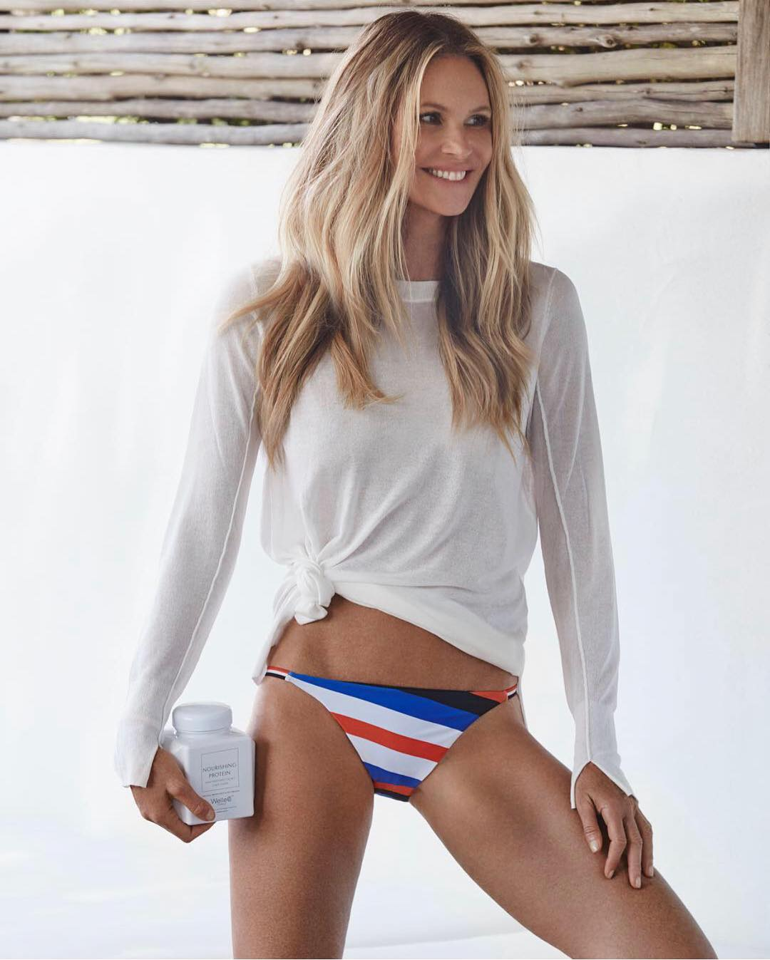 White Top And Multistriped Bikini Bottoms On Elle Macpherson 2019