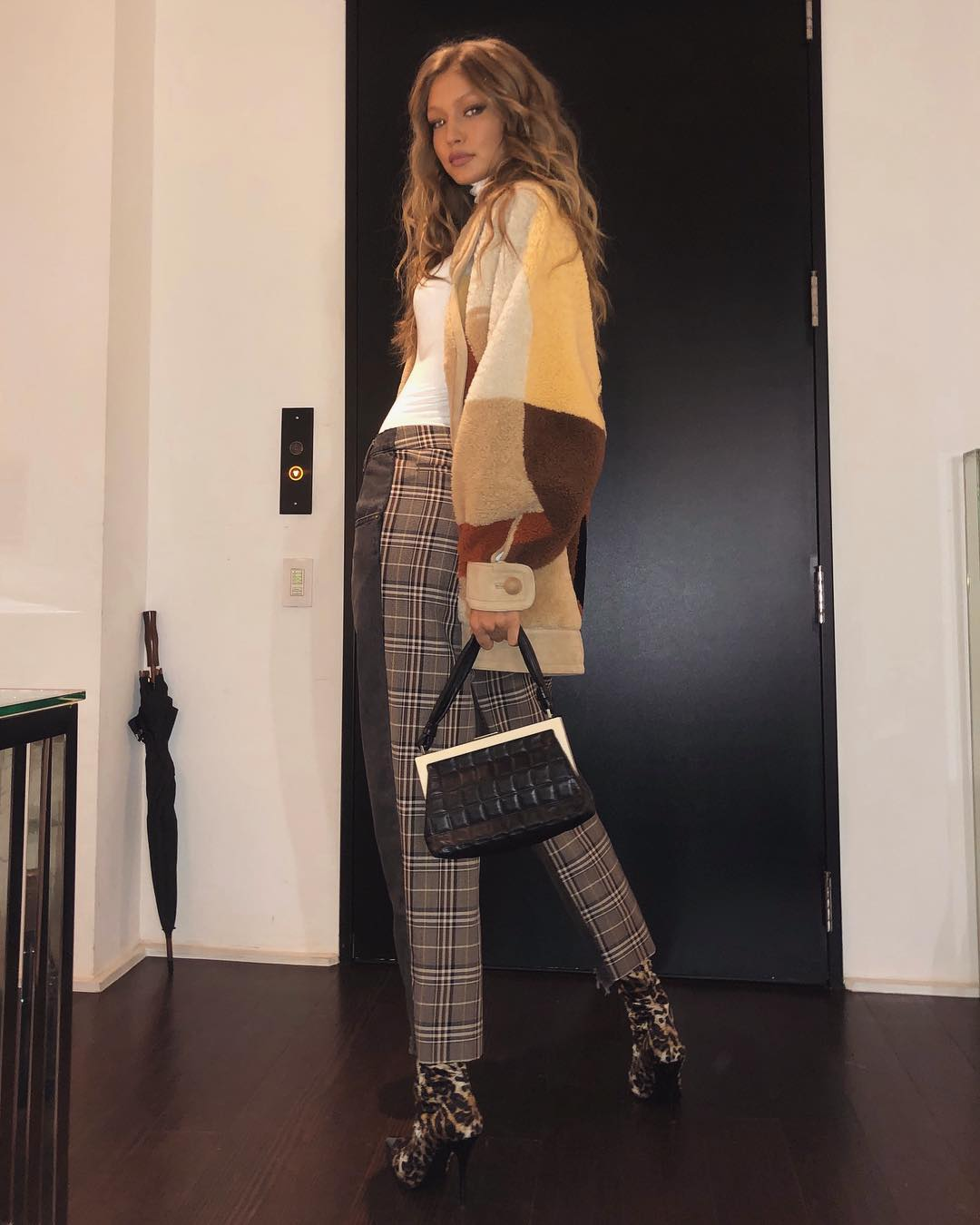 Gigi Hadid Wearing Teddy Bear Coat, White Turtleneck, Plaid Pants And Leopard Boots 2019