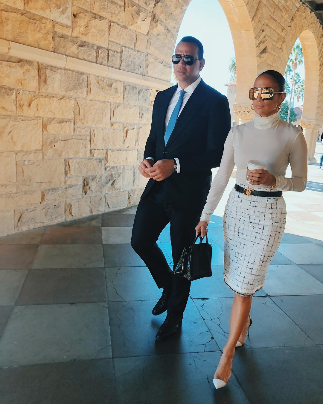 Jennifer Lopez With Sleek Back Hair, Oversized Mirrored Sunglasses And White Look 2019