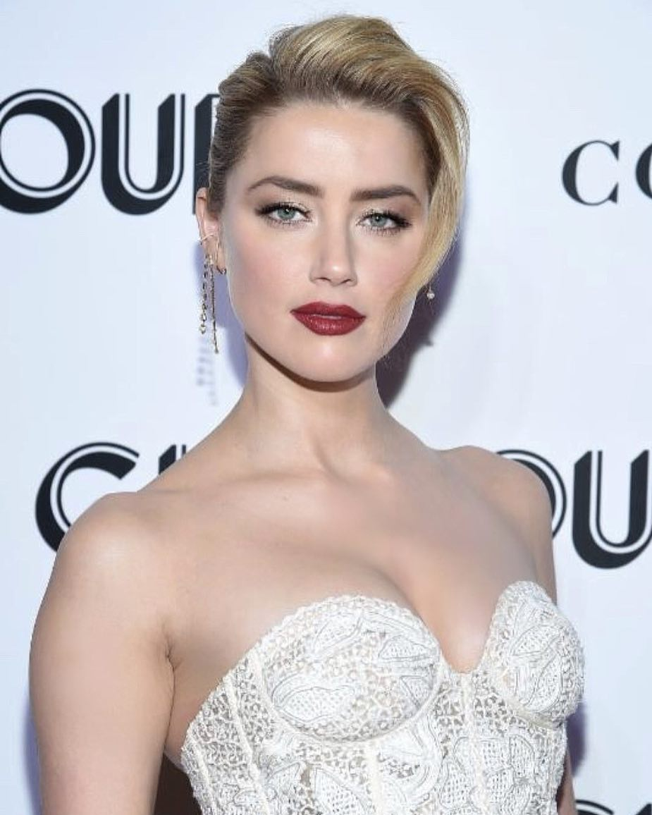 Amber Heard Wearing White Lace Corset Dress And Evening Hairdo 2021