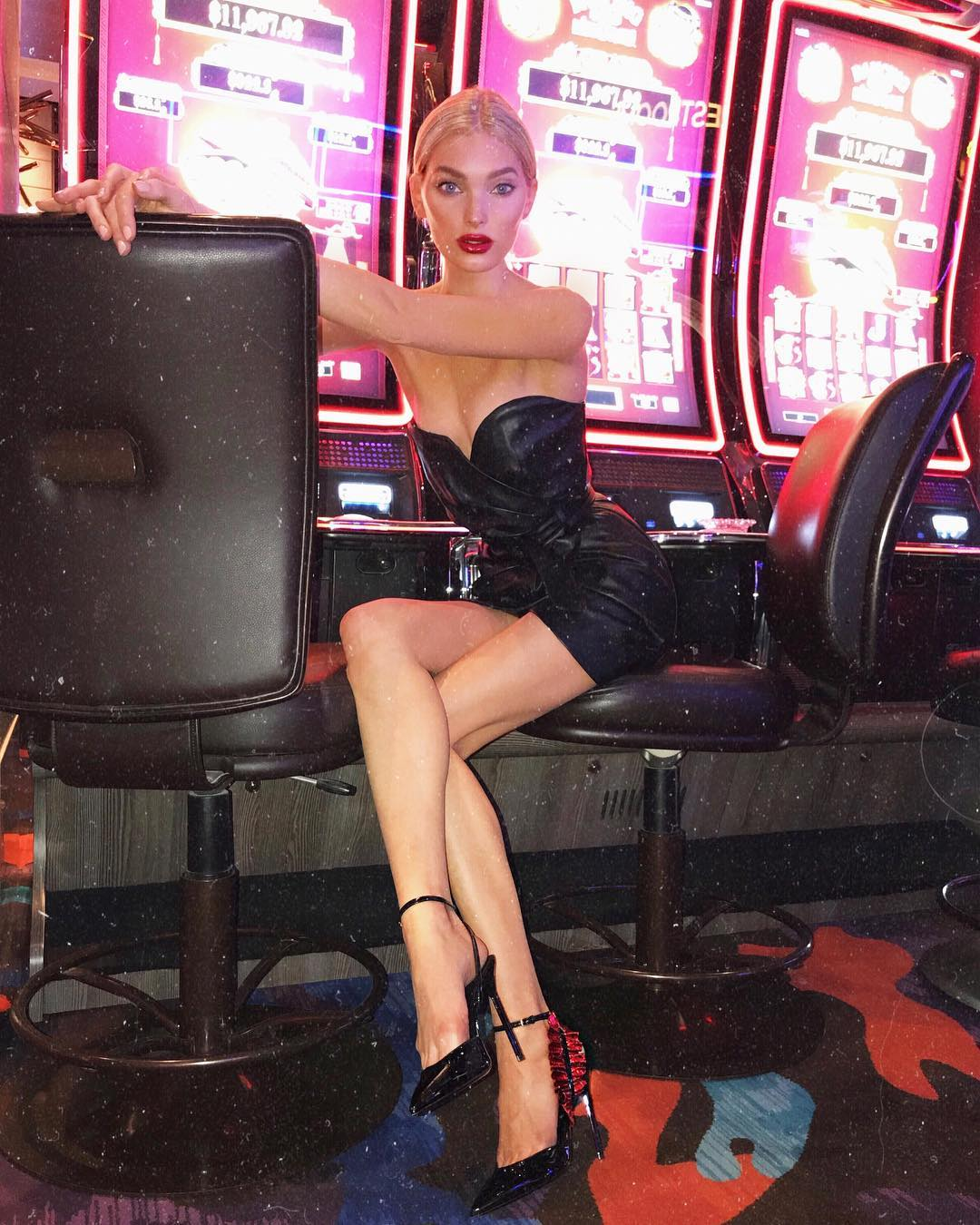 Elsa Hosk With Mid Part Sleek Hair, Red Lips And Black Leather Strapless Dress 2019