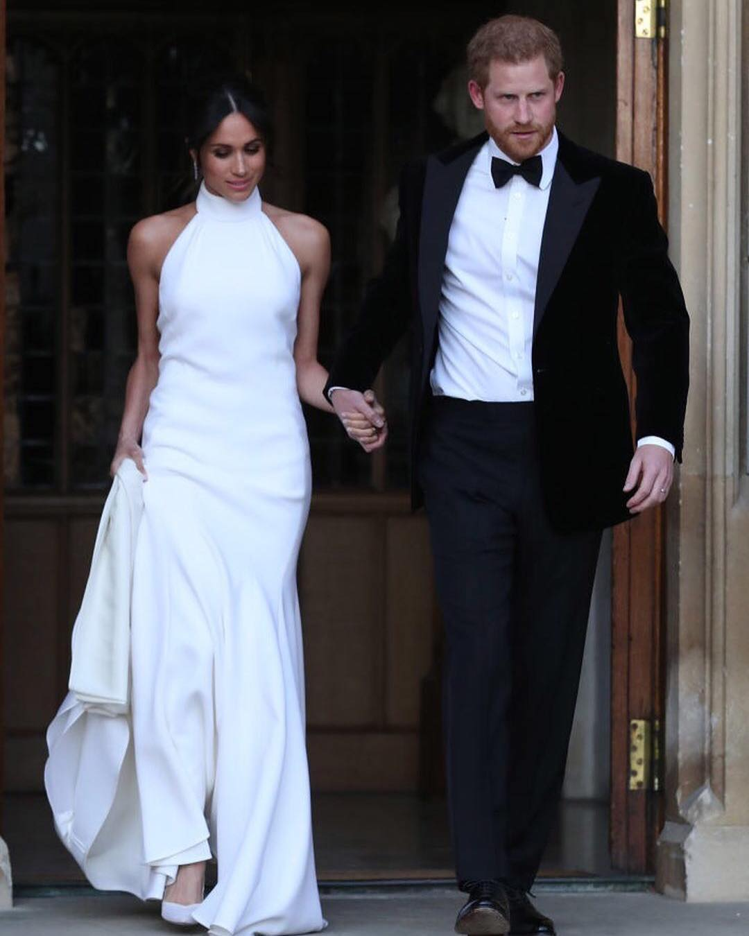 Meghan Markle Wearing High-Neck White Sleeveless Maxi Gown 2020
