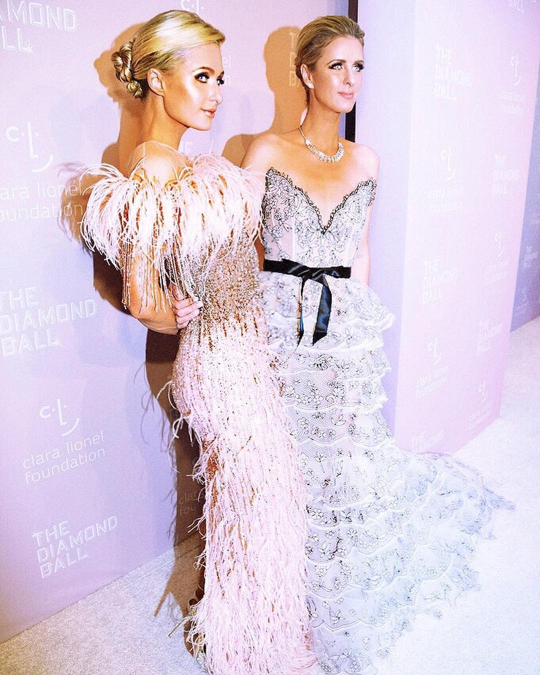 Paris Hilton Wearing Feathered Pencil Dress At Clara Lionel Foundation Event 2021