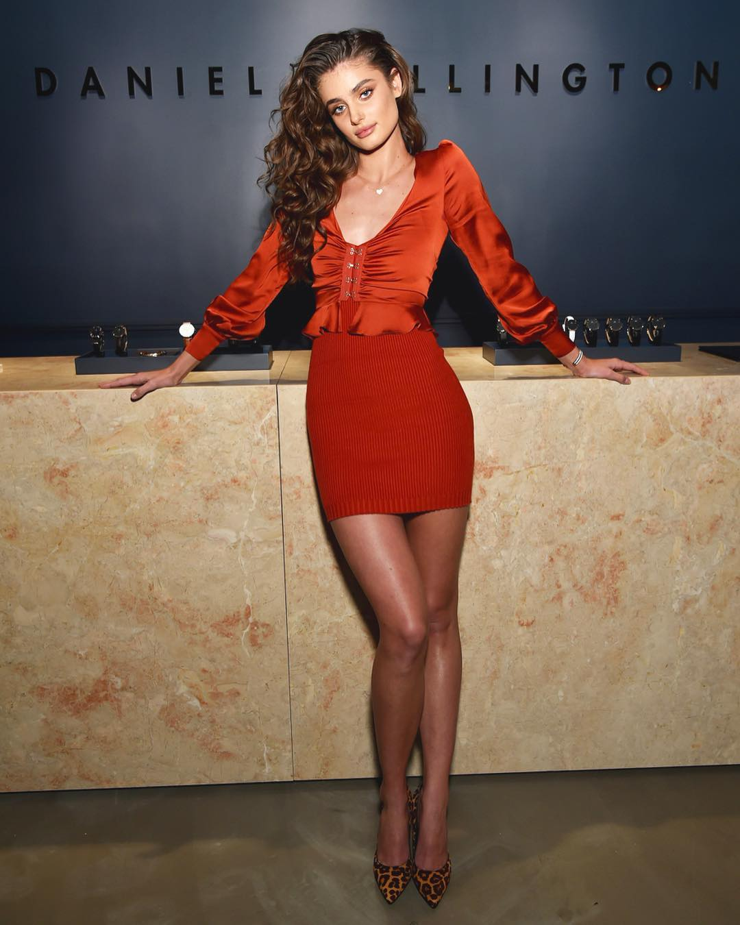Taylor Hill Wearing Red Orange Outfit During Daniel Wellington Store 2019