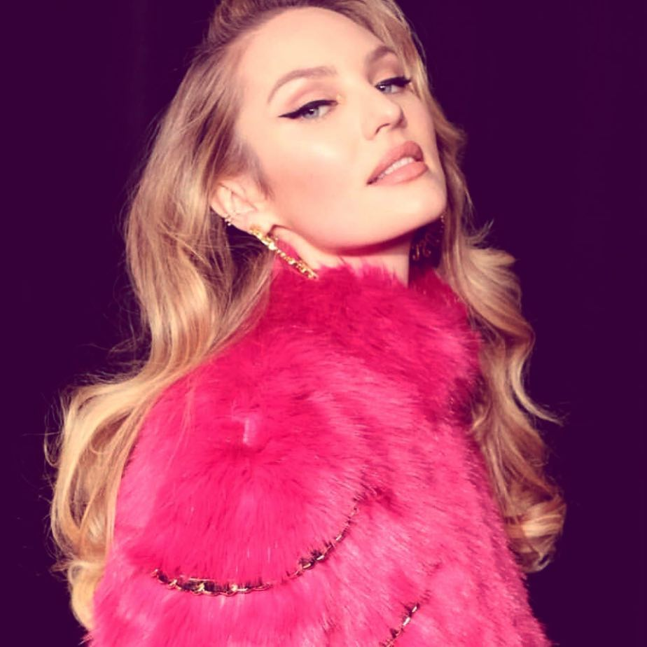 Candice Swanepoel Wearing Pink Fur Coat From HM & Moschino 2019