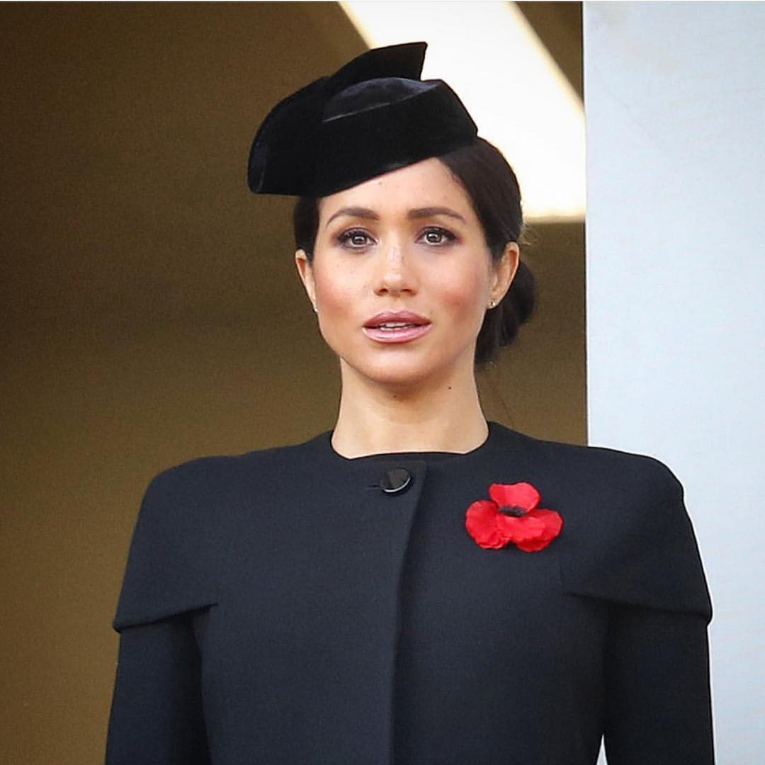 Meghan Markle Wearing Fancy Velvet Hat In Black And Collarless Suit 2019