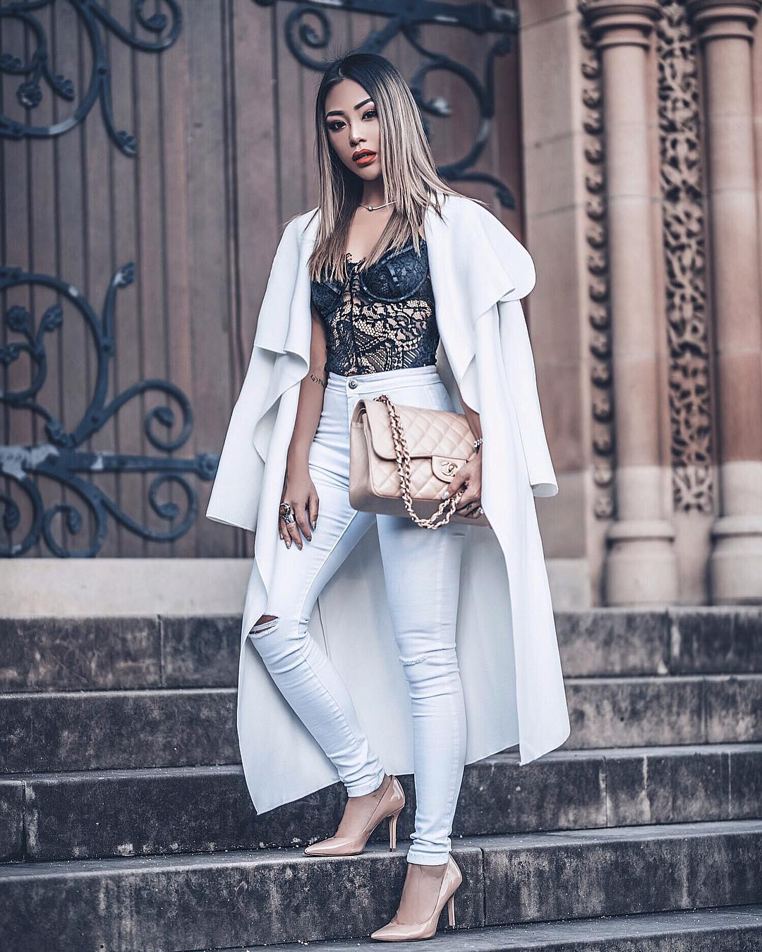 White Draped Long Coat Over Black Lace Bodysuit With White Skinny Jeans 2019