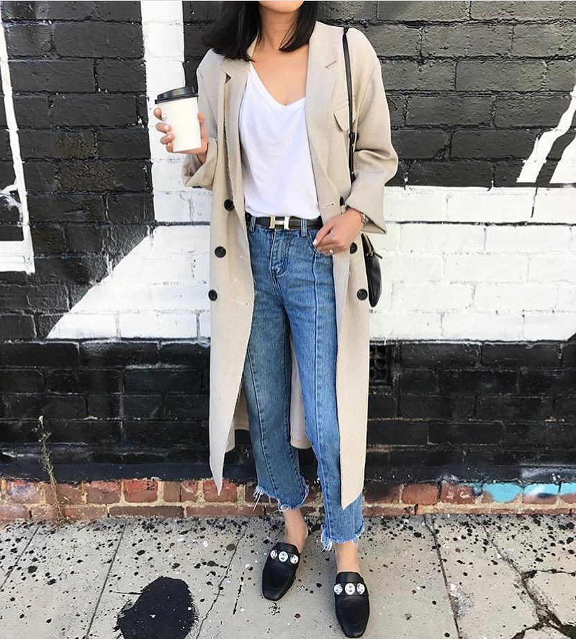 A Perfect Spring Outfit: Beige Trench Coat With Blue Ankle Jeans And Mules 2020