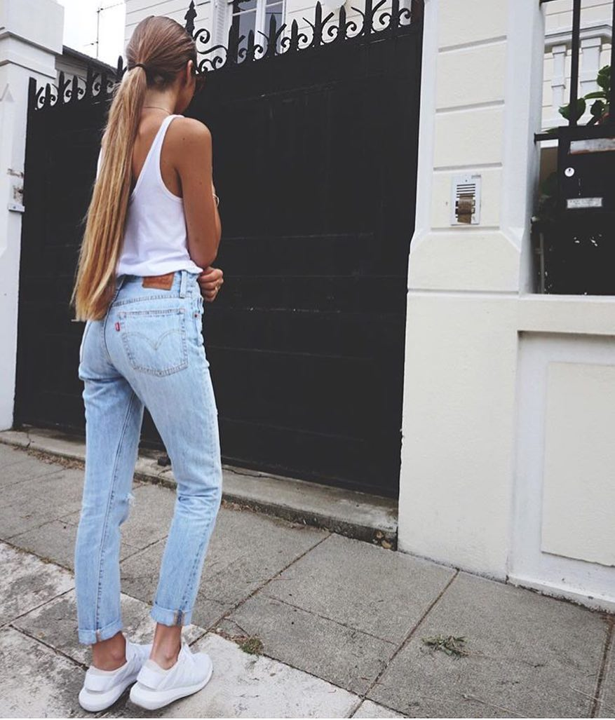 Lazy Casual Look For Day Walks: White Tank Top And Blue Jeans 2019