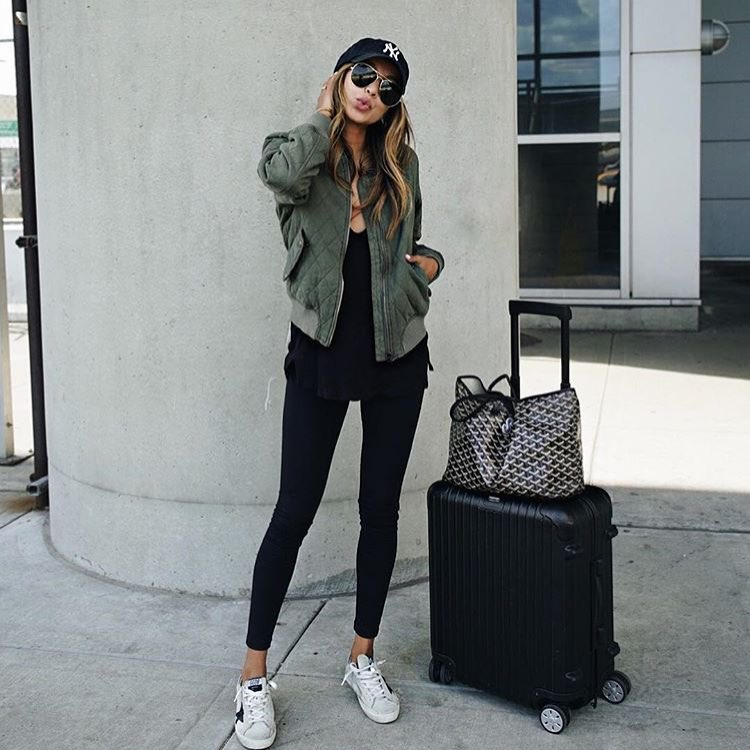 Casual Airport Outfit Idea: Green Bomber jacket, Black Leggings And Sneakers 2021
