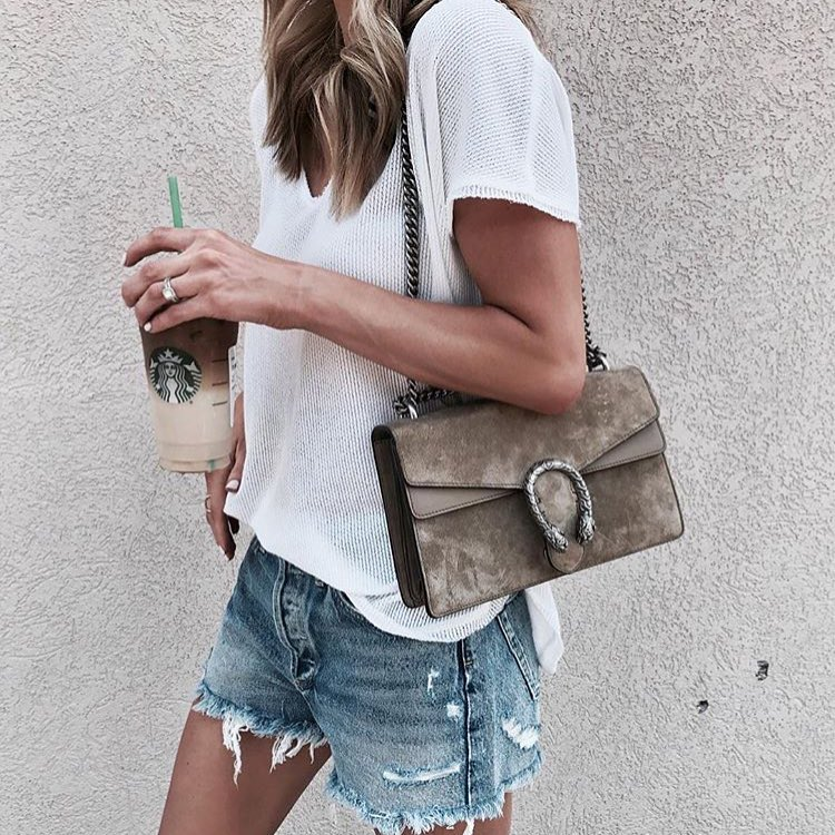 How To Wear White Knitted T-Shirt With Frayed Denim Shorts And Suede Clutch 2020