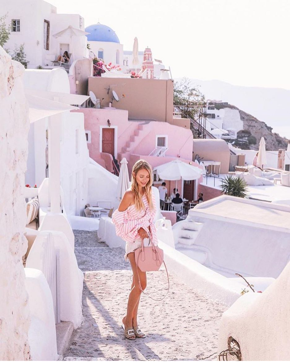 Santorini Outfit Ideas: Pink-White One Shoulder Blouse And White Denim Shorts 2020