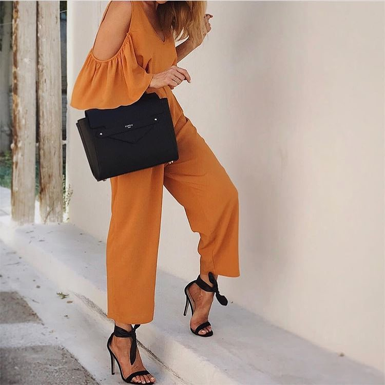How To Wear Cold Shoulder Jumpsuit In Light Orange With Black Heels 2020
