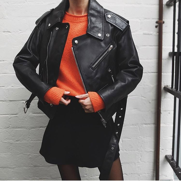 How To Wear Black Leather Jacket With Orange Sweater And Black Mini Skirt 2021