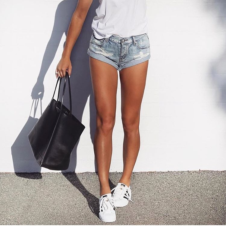 Simple Summer Casual Outfit: White Tee, Blue Denim Shorts, White Sneakers And Tote Bag 2019