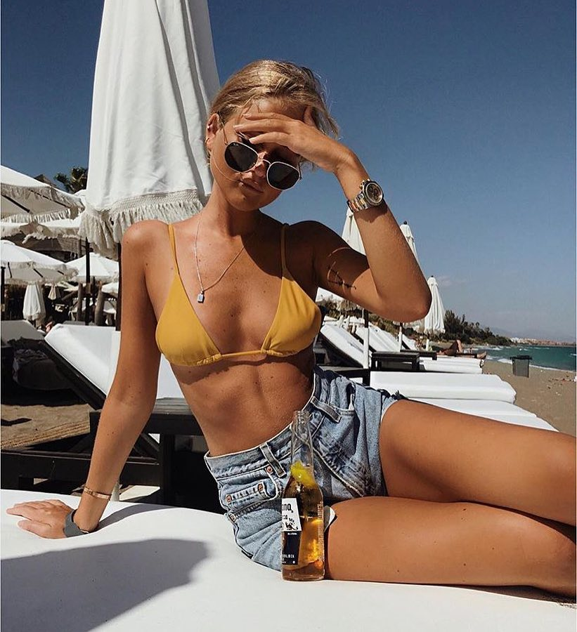 Look At Your Best At The Beach: Yellow Bikini Top And Blue Denim Shorts 2019