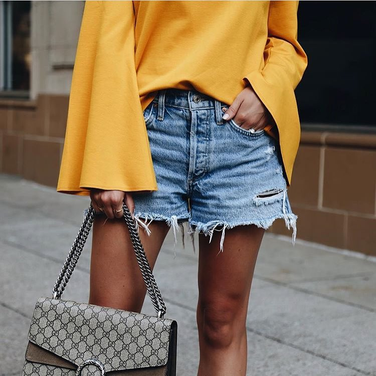 How To Wear Mustard Yellow Bell Sleeve Top With Ripped Denim Shorts 2020