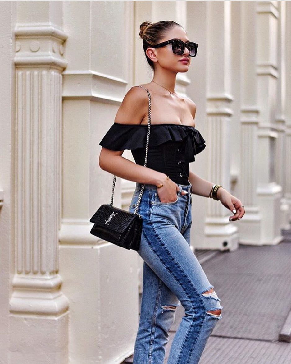 How To Style Ripped Light Blue Jeans With Off-Shoulder Ruffled Black Bodysuit 2020