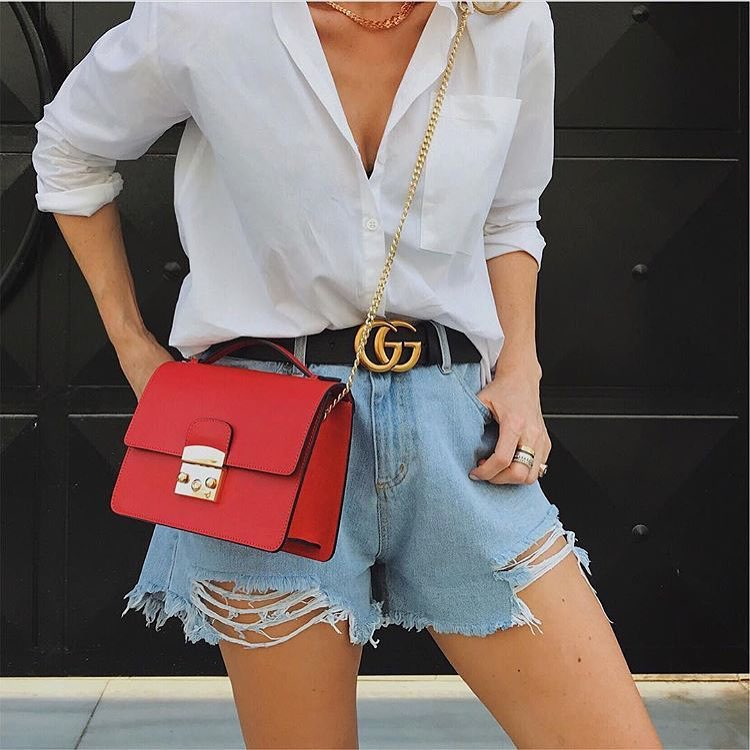 How To Style Chain Strap Red Clutch Bag With White Shirt And Blue Denim Shorts 2020