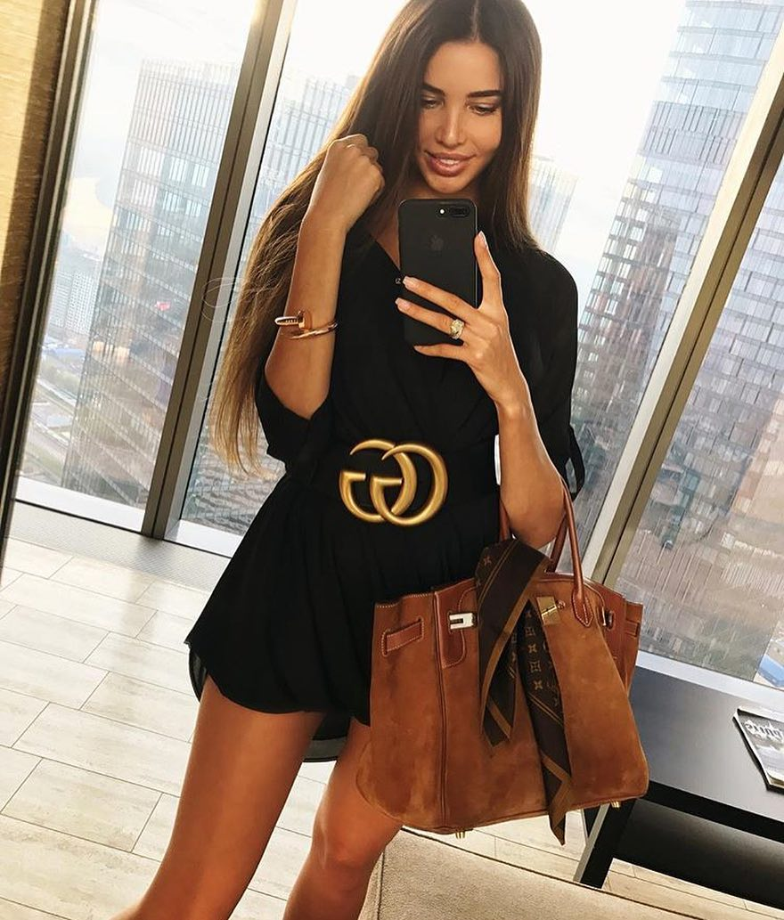 How To Wear A Black Wrap Dress With A Wide Gucci Belt And Suede Handbag 2020