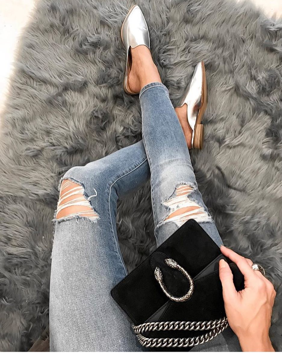 A Perfect Combo: Silver Metallic Backless Mules, Ripped Skinny Jeans And Black Clutch Bag 2019