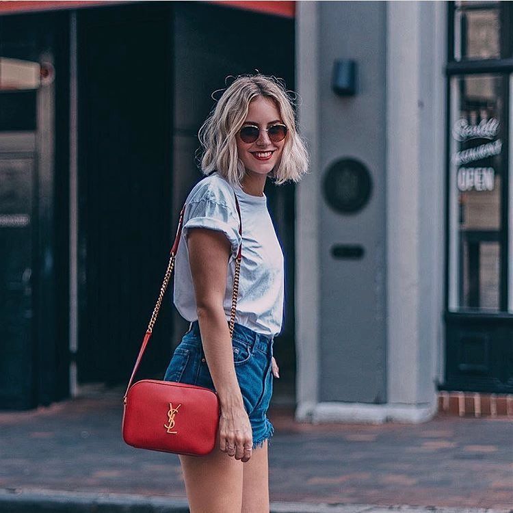 1990's Are Back: Rounded Shades, White T-Shirt, Blue Denim Shorts And Red Shoulder Bag 2020