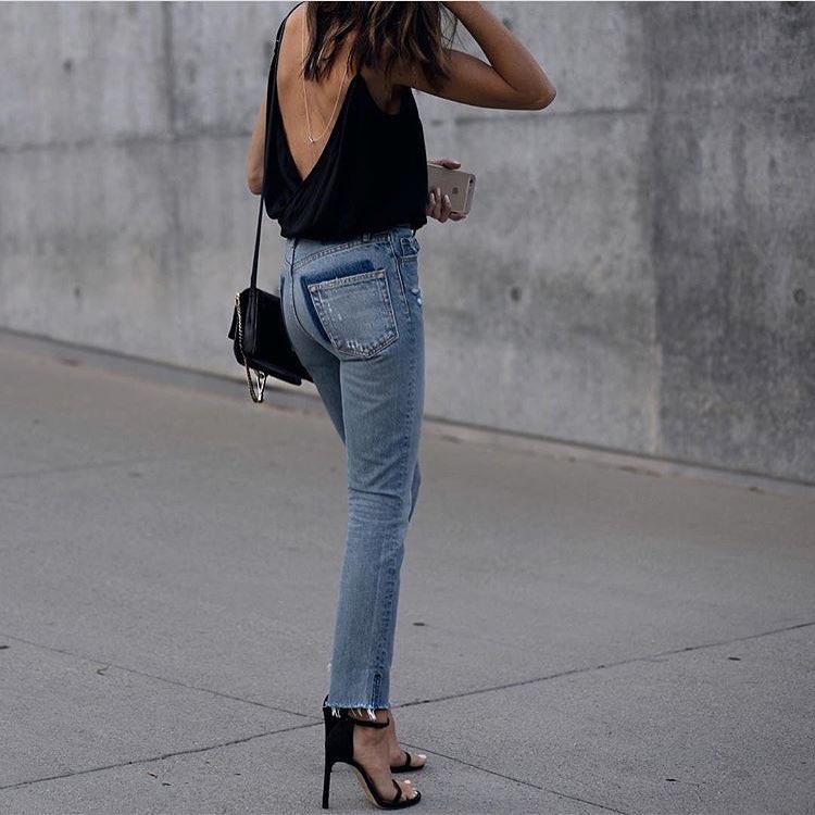 Summer Basics: Black Open Back Top, Blue Slim Jeans And Black Heels 2020