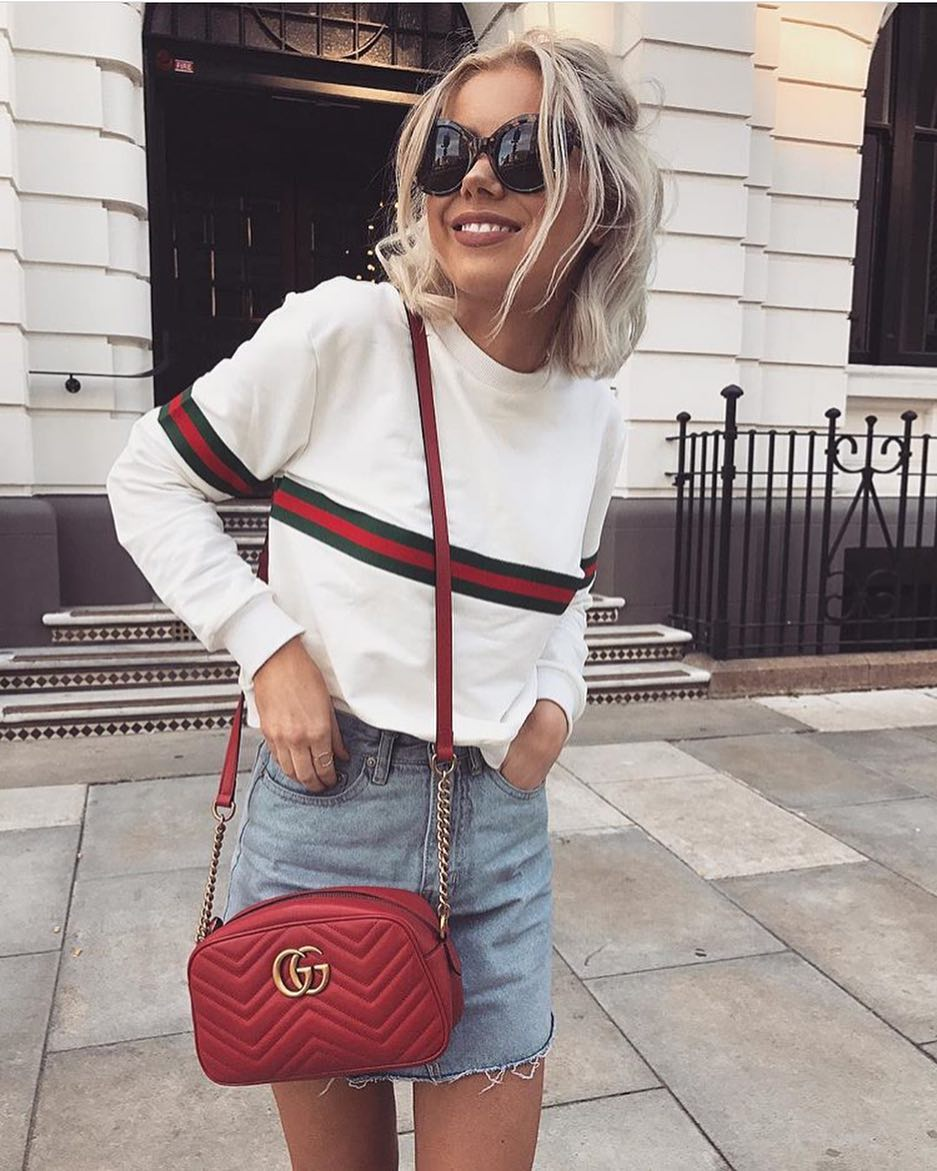 Summer Essentials: Tortoise Sunglasses, White Pullover, Frayed Denim Skirt And Red Bag 2019