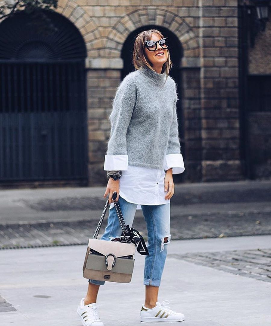 Parisian Casual Outfit: Grey Mohair Sweater Worn With White Shirt, Ripped Jeans And White Sneakers 2020