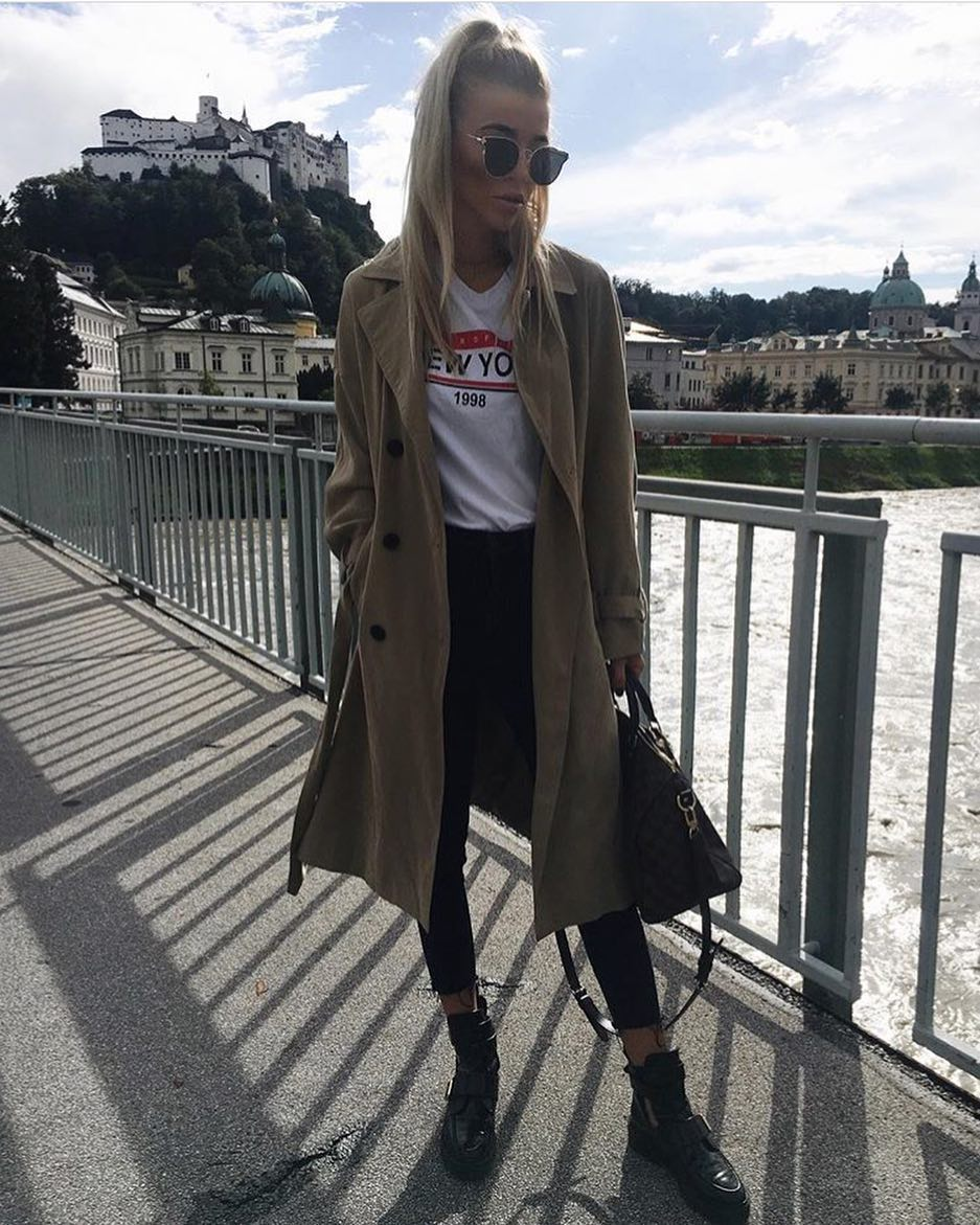 Long Beige Coat Over White T-Shirt Tucked In Black Skinny Jeans With Black Hi Top Sneakers 2019