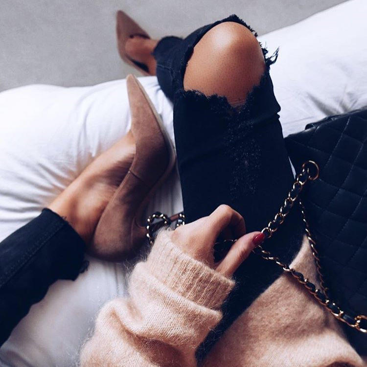 Spring Essentials: Suede Brown Pumps With Black Knee Ripped Jeans And Cream Sweater 2021