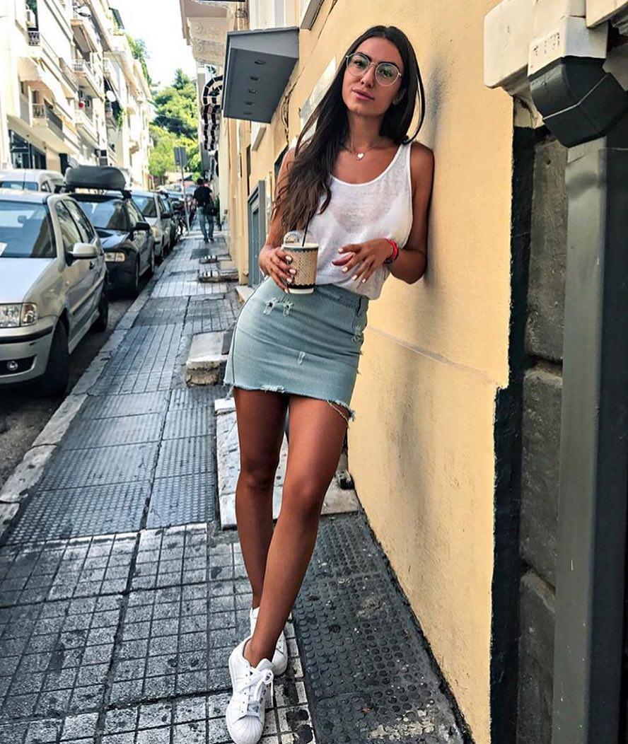 Italian Woman Style: White Tank Top Tucked In Ripped Denim Mini Skirt With White Kicks 2021