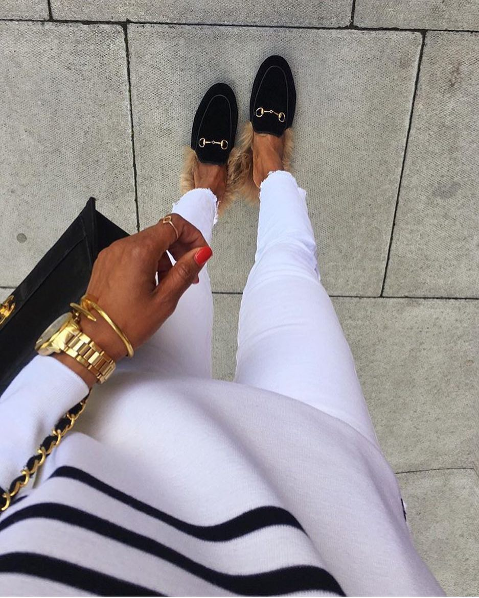 Fur Loafers With White Skinny Jeans And Striped White Sweater For Spring 2021