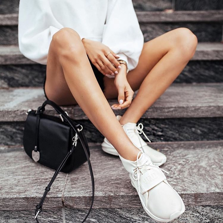 How To Wear Puff Sleeved White Blouse With Black Denim Shorts And White Sneakers 2020
