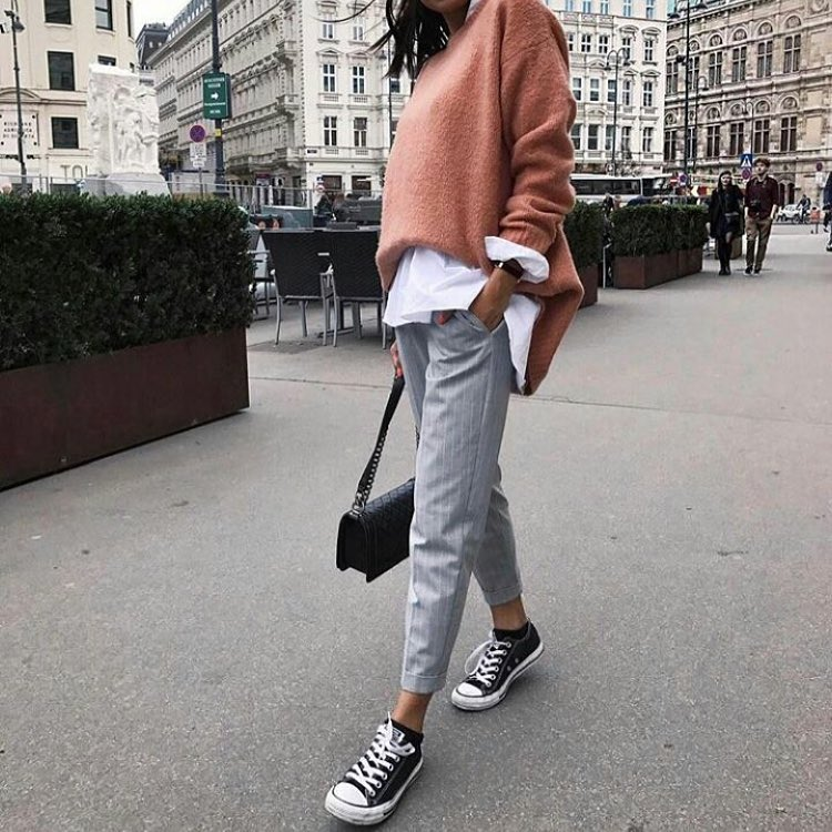 Blush Sweater With White Shirt And Pinstripe Grey Pants Completed With Trainers 2020
