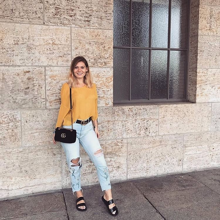 Yellow Silken Top And Ripped Boyfriend Jeans With Black Birks For Spring 2019