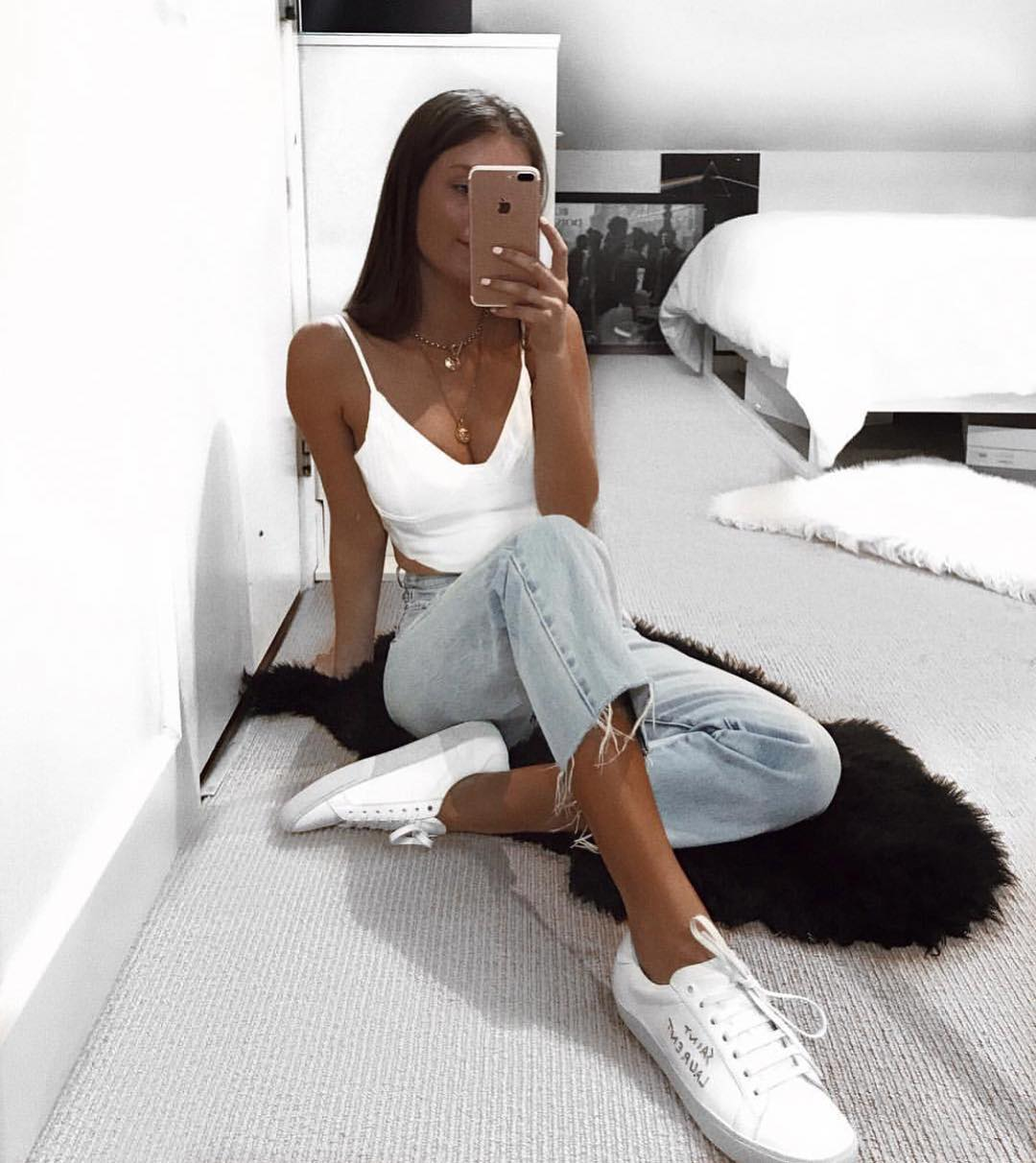 White Crop Top With Wash Blue Jeans And White Sneakers For Summer 2020