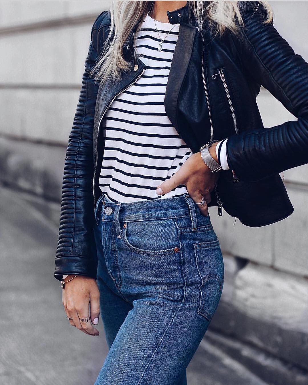 Black Leather Jacket, Striped Top And High Rise Jeans For Fall 2021